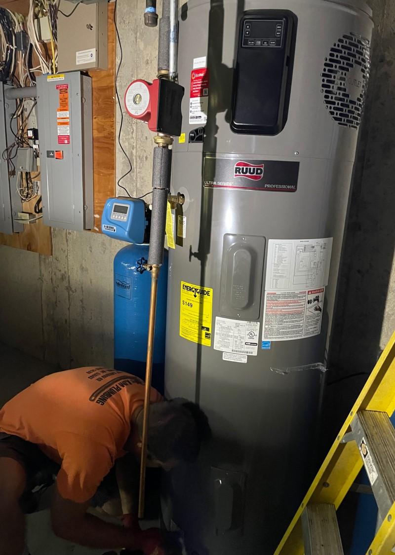 plumber installing the Ruud/Rheem 80 gallon hybrid electric heat pump water heater